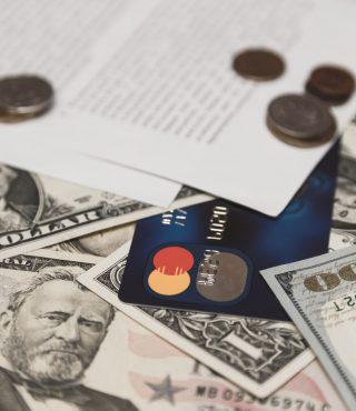 bank-credit-card-moneys-and-coins-and-bank-P9325B4