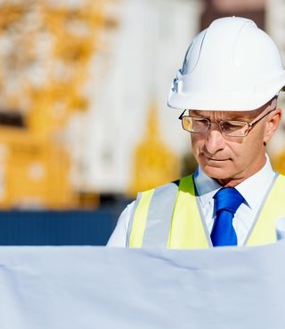 engineer-builder-at-construction-site-P7XHJ8C