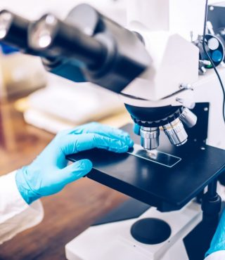 scientist-hands-using-microscope-for-chemistry-PJVC4S4-1024x684