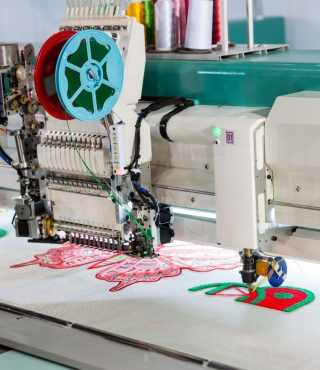 sewing-machine-on-textile-fabric-nobody-PMED6RP