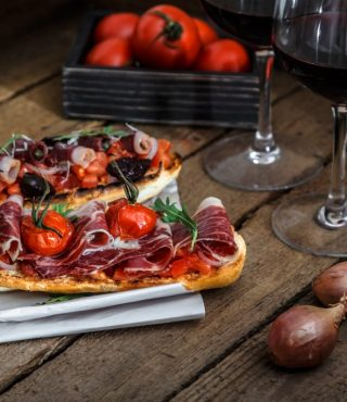 tapas-on-crusty-bread-with-red-wine-P2W8ASW-1024x683